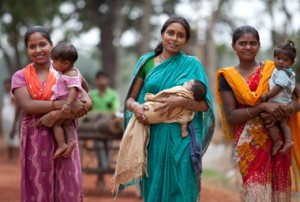 From left, villagers Lalita Devi with baby Suhani Kumari , Deepti Prabha with baby Amrita Kumari and Sugo Kachap and baby Anushika make their way from to their mud huts from the local Anganwadi centre at Lahna village to meet and gather information on pregnancy, breast feeding and post natal care of their children. Located outside Ranchi in Jharkhand, India the centre has been rolling out the breast feeding program as part of the IKEA Social Initiative, in conjunction with UNICEF and the Government , to combat poor child health from superstitions such as eating down during pregnancy and 'hell fasting' following delivery where the mother doesn't eat for days as an act of purification. Illnesses such as diarrhea can result when babies are not fed breast milk but substitutes such as goats milk and honey. The program is proving to be very successful with education and support provided by local health activists, volunteers and program officers. Picture by Graham Crouch/UNICEF